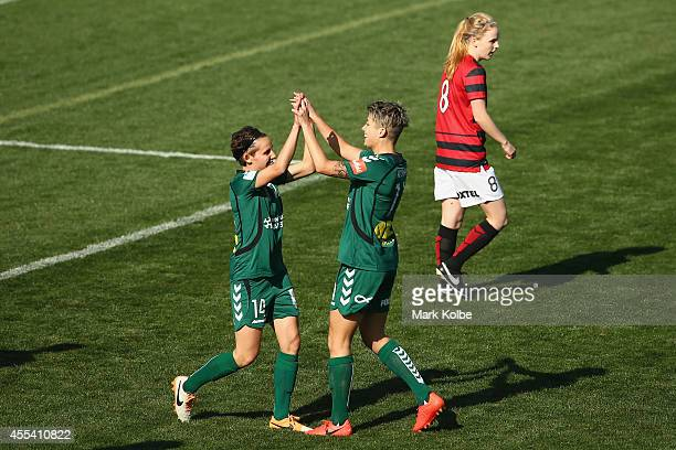 Michelle Heyman and Ashleigh Sykes of the United celebrate Heyman scoring a goal during the round one WLeague match between the Western Sydney...
