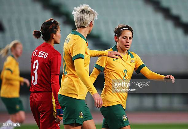 Michelle Heyman of Australia celebrates her team's eighth goal with her team mate Larissa Crummer during the AFC Women's Olympic Final Qualification...