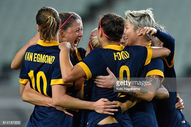 Michelle Heyman of Australia celebrates scoring her team's first goal with her team mates during the AFC Women's Olympic Final Qualification Round...