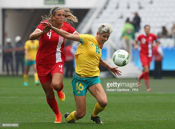 Michelle Heyman of Australia is fouled by Shelina Zadorsky of Canada during the Women's First Round Group F match between Canada and Australia at...