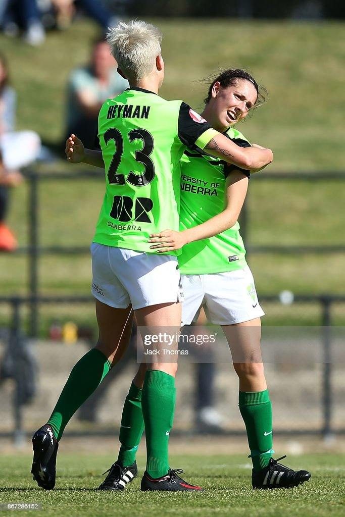 Michelle Heyman of Canberra (L) celebrates a goal during the round one W-League match between Melbourne Victory and Canberra United at Epping Stadium on October 28, 2017 in Melbourne, Australia.