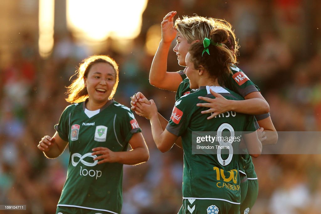 Michelle Heyman of Canberra celebrates with team mates after scoring the second goal for Canberra against the Wanderers during the round 11 W-League match between Canberra United and the Western Sydney Wanderers at McKellar Park on January 8, 2013 in Canberra, Australia.