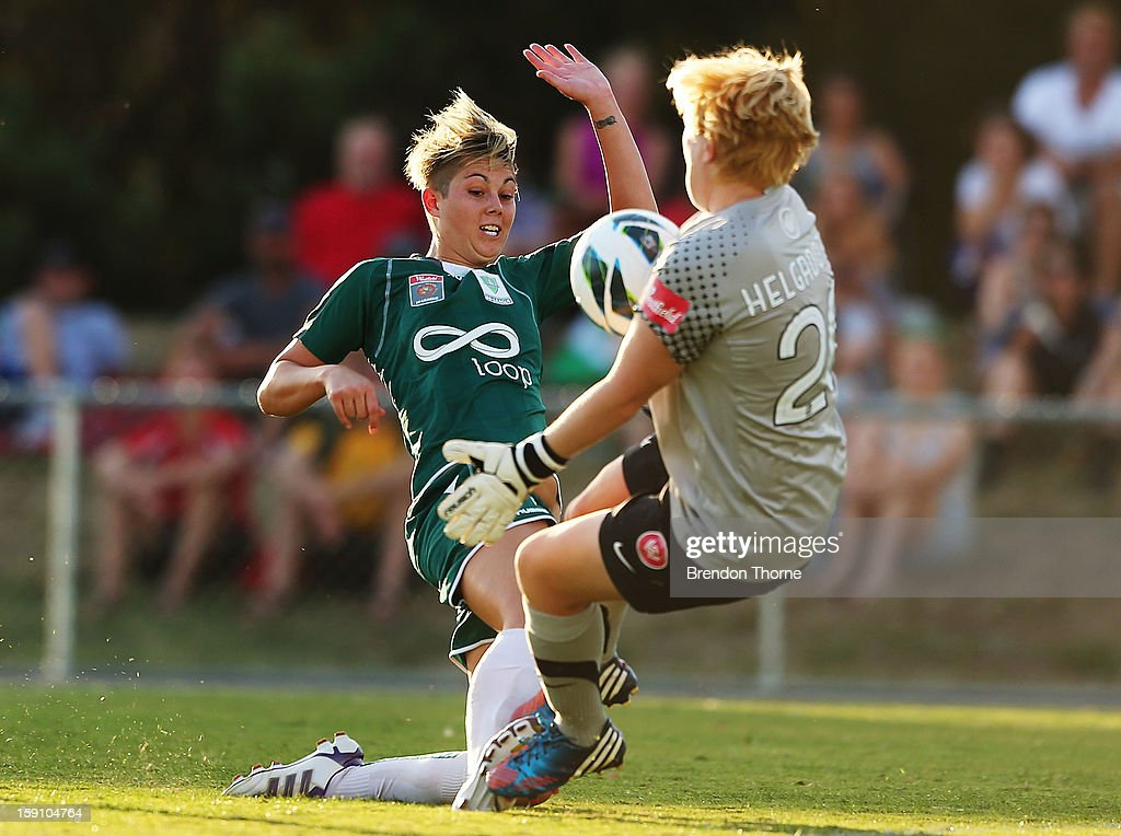 Michelle Heyman of Canberra competes with Thora Helgadottir of the Wanderers during the round 11 W-League match between Canberra United and the Western Sydney Wanderers at McKellar Park on January 8, 2013 in Canberra, Australia.