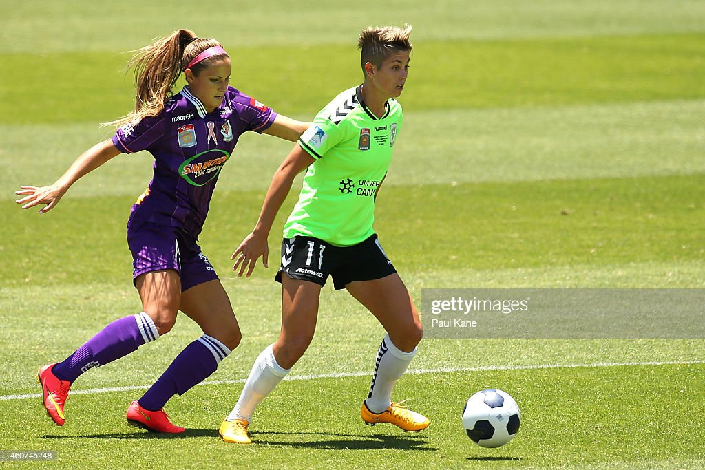 Michelle Heyman of Canberra holds off Shelina Zadorsky of the Glory during the W-League Grand Final match between Perth and Canberra at nib Stadium on December 21, 2014 in Perth, Australia.
