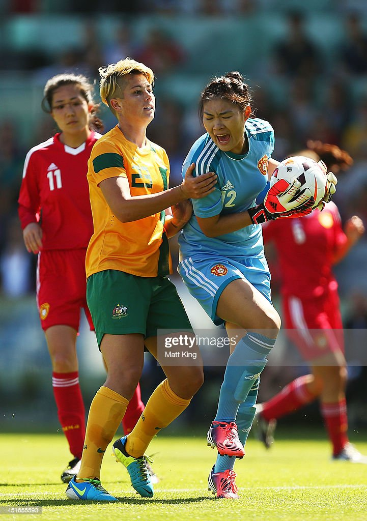 Michelle Heyman of the Matildas challenges goalkeeper Fei Wang of China during the match between the Australian Matildas and China PR at WIN Stadium...