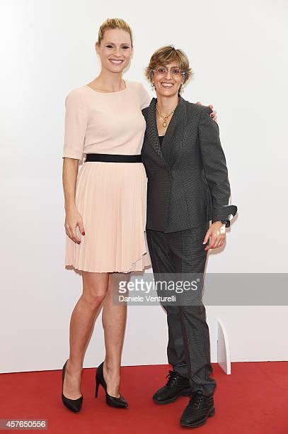 Michelle Hunziker and Giulia Bongiorno attend 'Doppia Difesa' Photocall during the 9th Rome Film Festival at Auditorium Parco Della Musica on October...