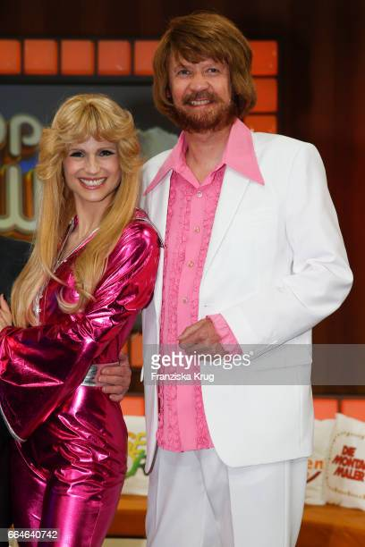 Michelle Hunziker and Guenther Jauch dressed as members of the Swedish band ABBA during the photo call for TV Show 'Top die Wette gilt 75 Jahre Frank...