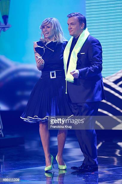 Michelle Hunziker and Hape Kerkeling attendsthe Goldene Kamera 2014 at Tempelhof Airport on February 01 2014 in Berlin Germany