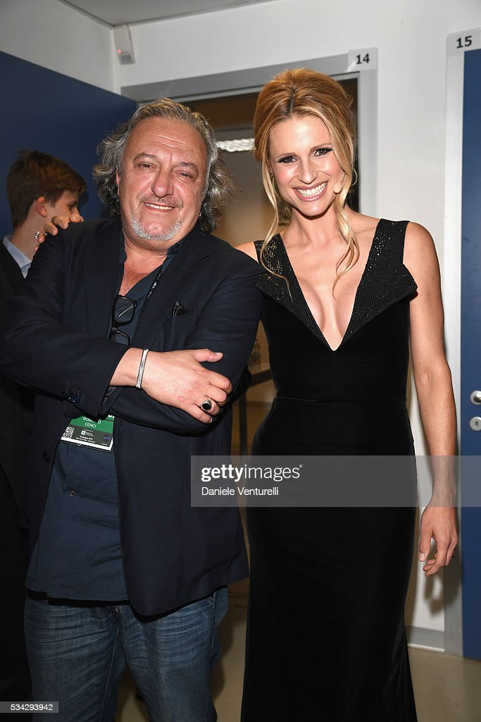 <a gi-track='captionPersonalityLinkClicked' href=/galleries/search?phrase=Michelle+Hunziker&family=editorial&specificpeople=577804 ng-click='$event.stopPropagation()'>Michelle Hunziker</a> and Roberto Cenci are seen backstage ahead of Bocelli and Zanetti Night on May 25, 2016 in Rho, Italy.
