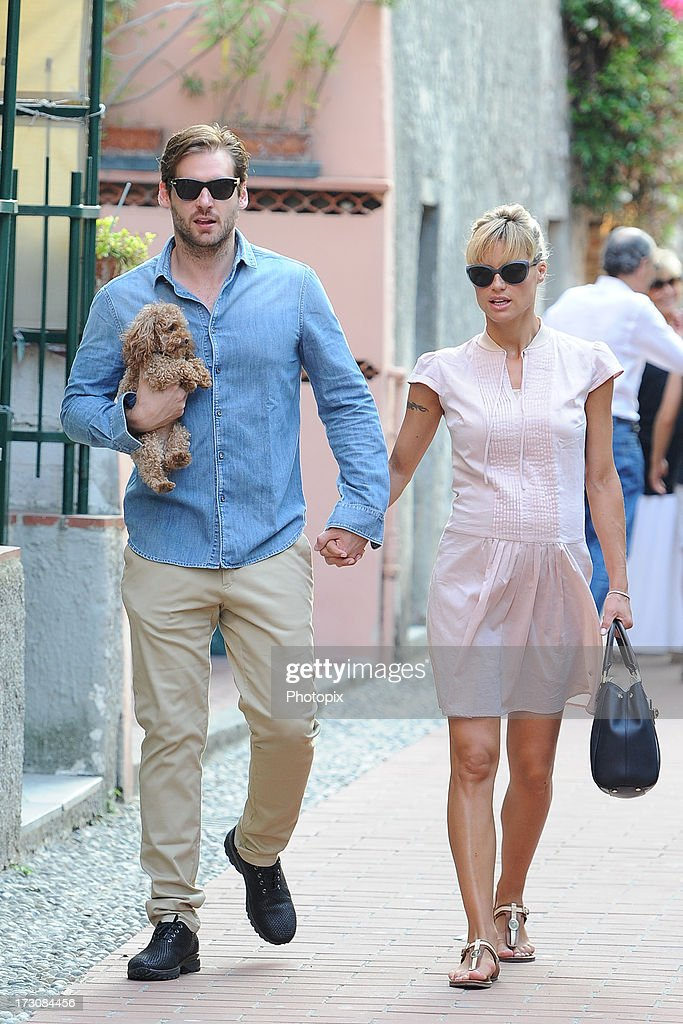 <a gi-track='captionPersonalityLinkClicked' href=/galleries/search?phrase=Michelle+Hunziker&family=editorial&specificpeople=577804 ng-click='$event.stopPropagation()'>Michelle Hunziker</a> and <a gi-track='captionPersonalityLinkClicked' href=/galleries/search?phrase=Tomaso+Trussardi&family=editorial&specificpeople=7432709 ng-click='$event.stopPropagation()'>Tomaso Trussardi</a> are seen on July 6, 2013 in Varigotti, Italy.