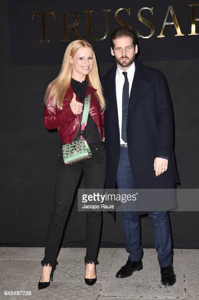 Michelle Hunziker and Tomaso Trussardi attend the Trussardi show during Milan Fashion Week Fall/Winter 2017/18 on February 26 2017 in Milan Italy