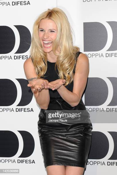Michelle Hunziker attends 2012 Doppia Difesa Cocktail Party on March 28 2012 in Milan Italy