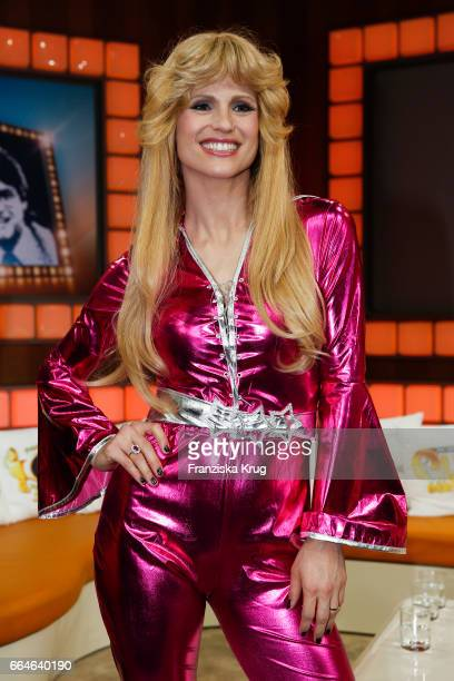 Michelle Hunziker dressed as a member of the Swedish band ABBA during the photo call for TV Show 'Top die Wette gilt 75 Jahre Frank Elstner' in...