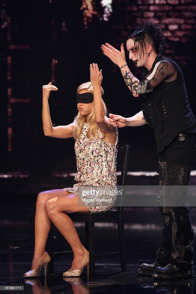 <a gi-track='captionPersonalityLinkClicked' href=/galleries/search?phrase=Michelle+Hunziker&family=editorial&specificpeople=577804 ng-click='$event.stopPropagation()'>Michelle Hunziker</a> gets a pin of Dan Sperry through her arm during the First Live Show of 'Das Supertalent' on December 1, 2012 in Cologne, Germany.