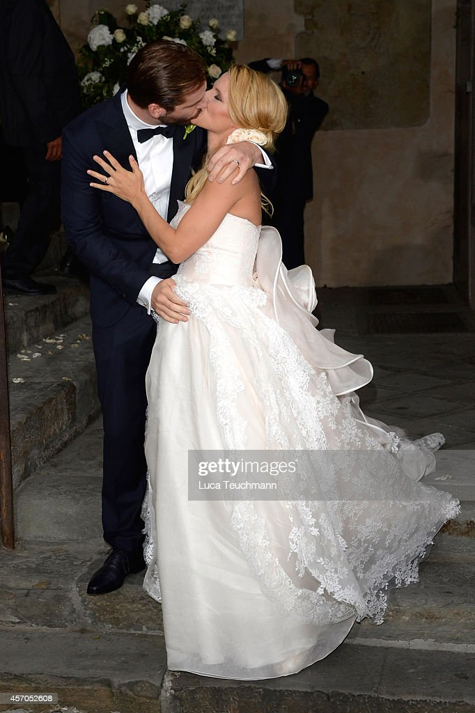 Michelle Hunziker leaves her wedding with her new husband Tomaso Trussardi at Palazzo della Ragione on October 10 2014 in Bergamo Italy