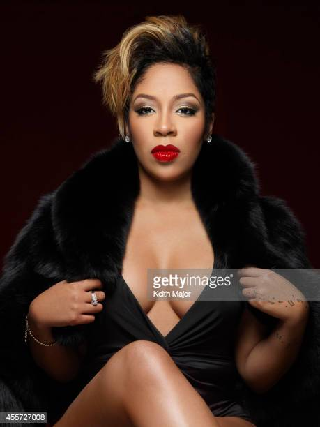 K Michelle is photographed at a portrait shoot in December 2013 in New York City