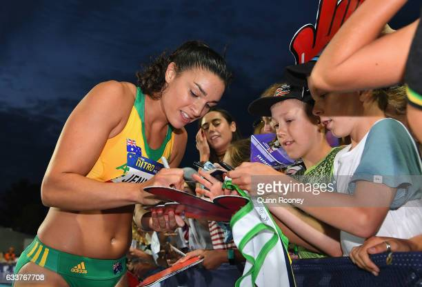 Michelle Jenneke of Australia signs autographs after competing in the 100 Metre Women's Hurdles during Nitro Athletics at Lakeside Stadium on...