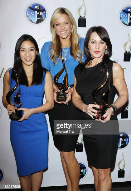 Michelle Kwan Jennie Finch and Nadia Comaneci arrive at the Power Of I Celebrating Women And Sport gala dinner at The International Olympic Committee...