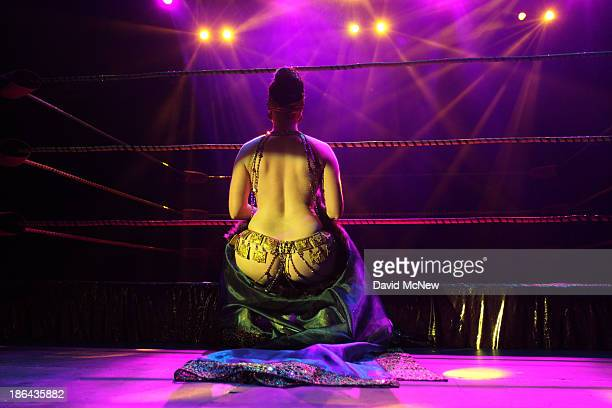Michelle L' Amour performs at the Lucha Vavoom Noche de los Salvajes Halloween show at the Mayan Theater on October 30 2013 in Los Angeles California...