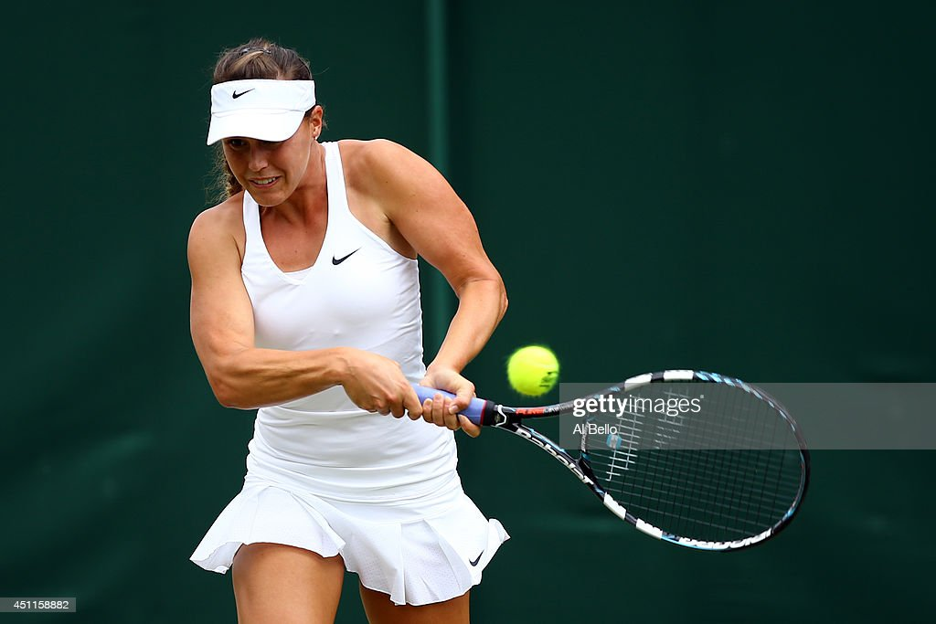 Michelle Larcher De Brito of Portugal in action during her Ladies' Singles first round match against against Svetlana Kuznetsova of Russia on day two of the Wimbledon Lawn Tennis Championships at the All England Lawn Tennis and Croquet Club at Wimbledon on June 24, 2014 in London, England.