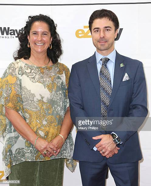 Michelle Levetro and Brad Lewis arrive at eZWay August Issue Celebration on August 27 2016 in Mission Viejo California