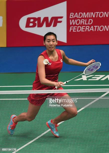 Michelle Li of Canada competes against Sri Fatmawati of Indonesia during Womens single qualification round match of the BCA Indonesia Open Super...