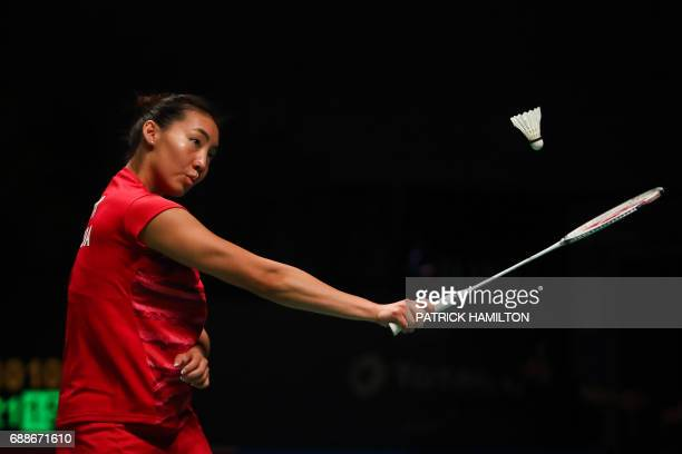 Michelle Li of Canada hits a return during the women's singles Sudirman Cup match against Wendy Chen HsuanYu of Australia at the Gold Coast Sports...