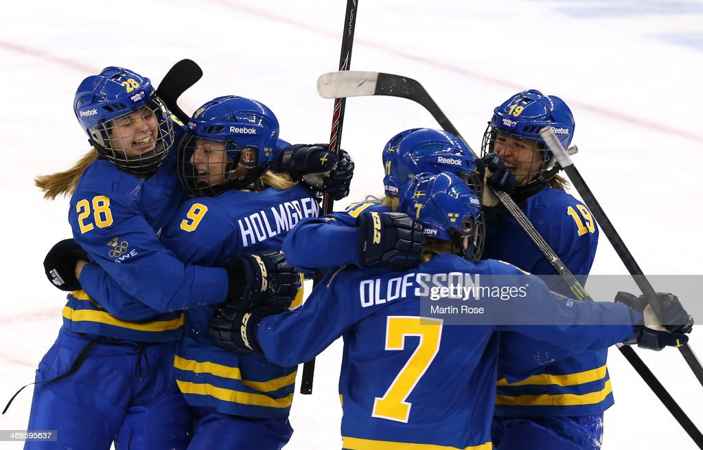 Michelle Lowenhielm (1st L) #28 of Sweden celebrates scoring their third goal against of Germany with her teammates Josefine Holmgren #9, Johanna Olofsson, Cecilia Osterberg and Maria Lind #19 of Sweden in the third period during the Women's Ice Hockey Preliminary Round Group B game on day four of the Sochi 2014 Winter Olympics at Shayba Arena on February 11, 2014 in Sochi, Russia.