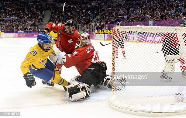 Michelle Lowenhielm of Sweden scores a goal against Florence Schelling of Switzerland during the Ice Hockey Women's Bronze Medal Game on day 13 of...
