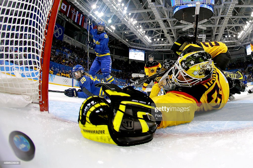 Michelle Lowenhielm #28 of Sweden scores their third goal against Jennifer Harss #30 of Germany in the third period during the Women's Ice Hockey Preliminary Round Group B game on day four of the Sochi 2014 Winter Olympics at Shayba Arena on February 11, 2014 in Sochi, Russia.
