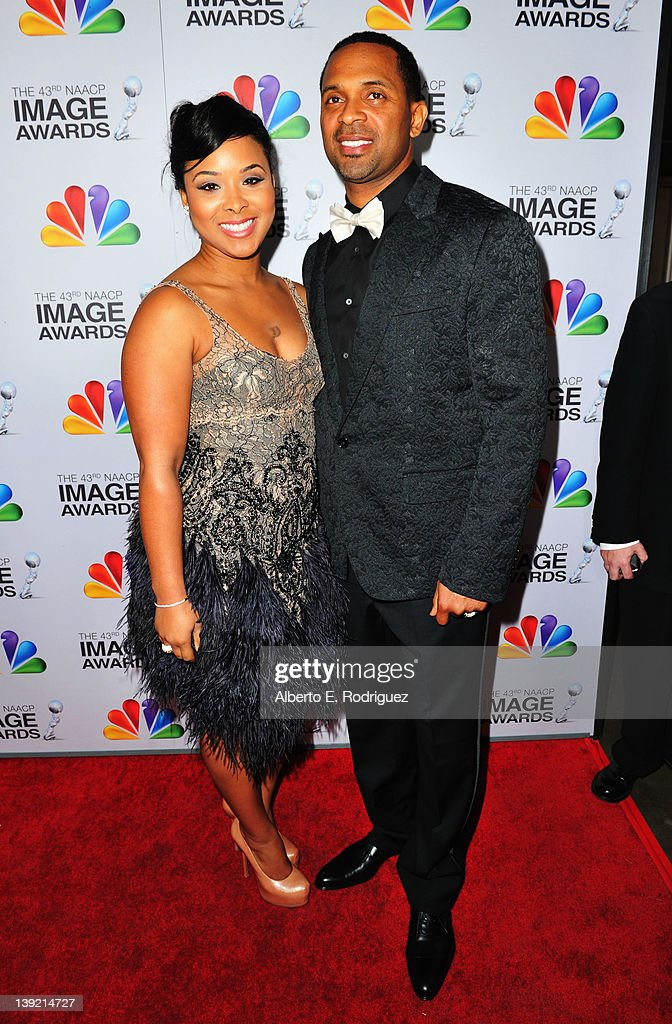 Michelle McCain (L) and actor Mike Epps arrive at the 43rd NAACP Image Awards held at The Shrine Auditorium on February 17, 2012 in Los Angeles, California.