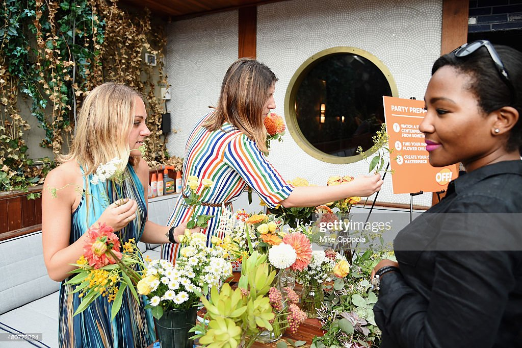 Michelle McSwain and Sarah Haman of Something May Floral create centerpieces at the It's Officially Summer event with OFF and Guest of a Guest at...