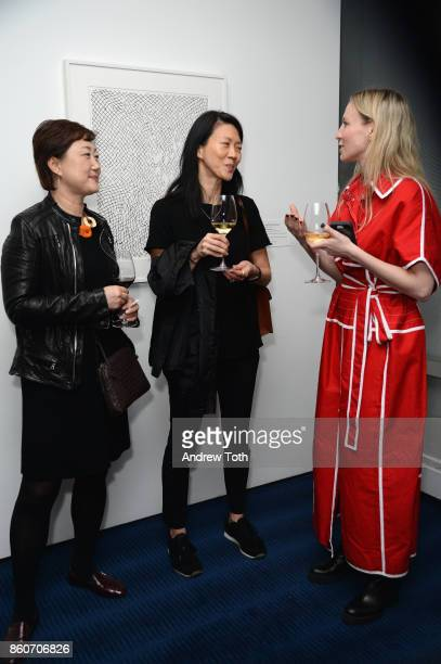 Michelle Miller Fisher and guests attend as Harper's BAZAAR and THE OUTNETCOM Celebrate the opening of MoMA's Fashion Exhibit 'Is Fashion Modern' at...