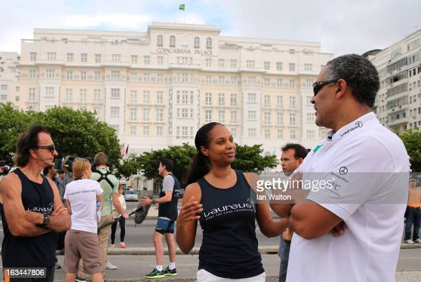 Michelle Moses speaks with Laureus Academy Member Daley Thompson during the Laureus Run Copacabana Beach on March 10 2013 in Rio de Janeiro Brazil