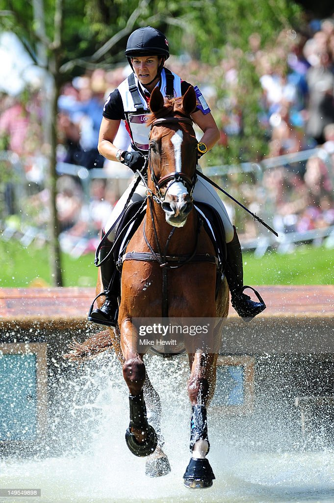 Michelle Mueller of Canada riding Amistad negotiates a jump in the Eventing Cross Country Equestrian event on Day 3 of the London 2012 Olympic Games at Greenwich Park on July 30, 2012 in London, England.