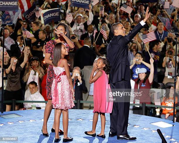 Michelle Obama Malia Obama Sasha Obama and US Sen Barack Obama stand on stage after he accepted the Democratic presidential nomination at Invesco...