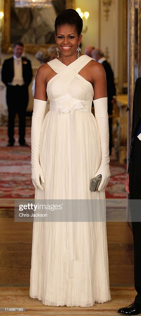 <a gi-track='captionPersonalityLinkClicked' href=/galleries/search?phrase=Michelle+Obama&family=editorial&specificpeople=2528864 ng-click='$event.stopPropagation()'>Michelle Obama</a> poses in the Music Room of Buckingham Palace ahead of a State Banquet on May 24, 2011 in London, England. The 44th President of the United States, Barack Obama, and his wife Michelle are in the UK for a two day State Visit at the invitation of HM Queen Elizabeth II. During the trip they will attend a state banquet at Buckingham Palace and the President will address both houses of parliament at Westminster Hall.