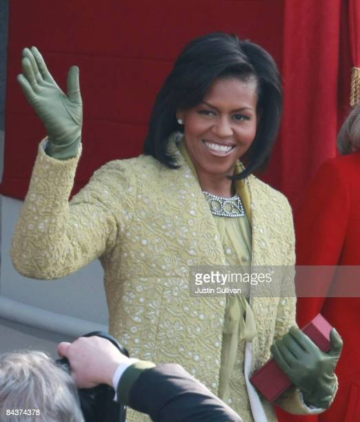 Michelle Obama waves as she arrives at the inauguration of Barack Obama as the 44th President of the United States of America on the West Front of...