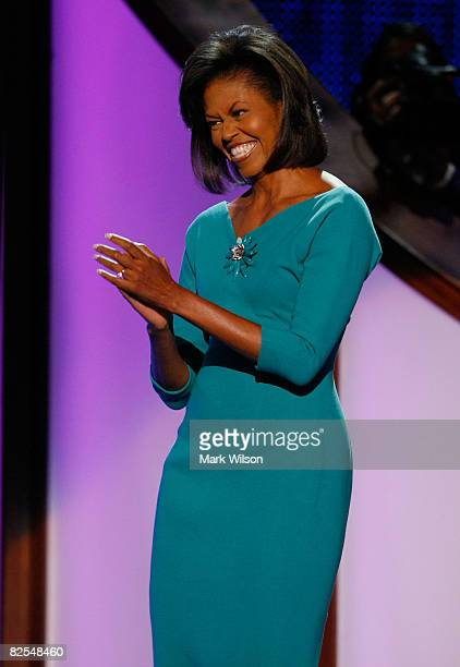 Michelle Obama wife of presumptive Democratic nominee US Sen Barack Obama walks on to the stage during day one of the Democratic National Convention...