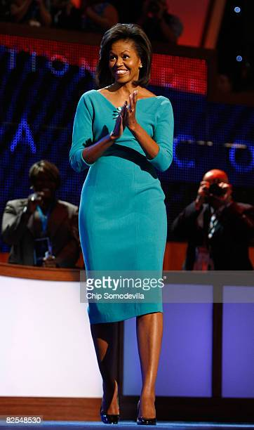 Michelle Obama wife of presumptive Democratic nominee US Sen Barack Obama walks on stage during day one of the Democratic National Convention at the...