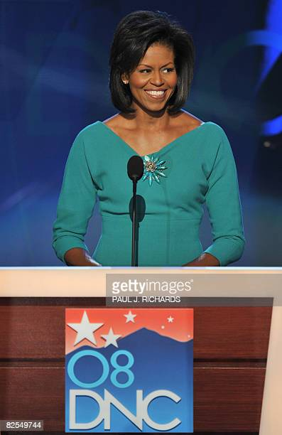Michelle Obama wife of US Democratic presidential candidate Barack Obama greets the audience at the Democratic National Convention 2008 at the Pepsi...