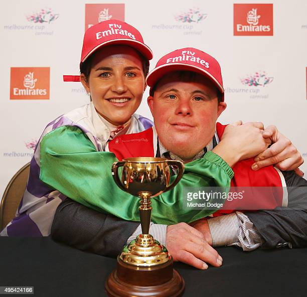 Michelle Payne celebrates her winning ride on Prince Of Penzance after race 7 the Emirates Melbourne Cup with brother and strapper Stephen Payne on...