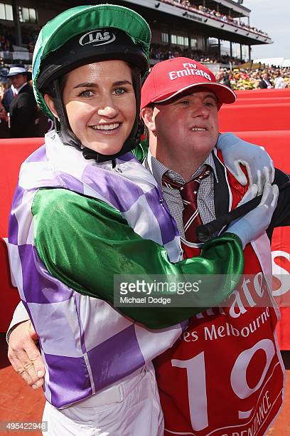 Michelle Payne celebrates her winning ride on Prince Of Penzance to win race 7 the Emirates Melbourne Cup with brother and strapper Stephen Payne on...