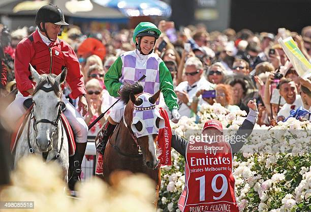 Michelle Payne is congratulated by her brother Steven Payne who has Down syndrome and works as a strapper after Michelle Payne riding Prince Of...