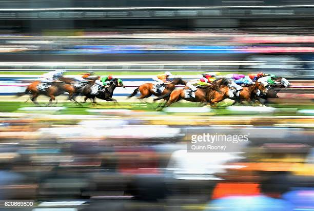 Michelle Payne riding Tavi Bay leads the field across the line to win race 1 the Red Rock Deli Plate on Oaks Day at Flemington Racecourse on November...