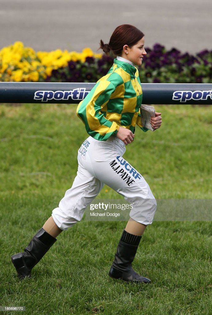 Michelle Payne runs on the track to inspect it before riding Lake Sententia in race 9 the Eliza Park International Stakes during Cox Plate Day at Moonee Valley Racecourse on October 26, 2013 in Melbourne, Australia.