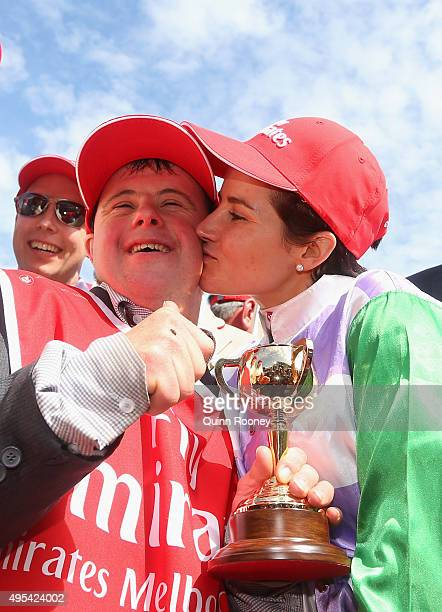 Michelle Payne who rode Prince of Penzance to win race 7 the Emirates melbourne Cup kisses strapper Stephen Payne on Melbourne Cup Day at Flemington...