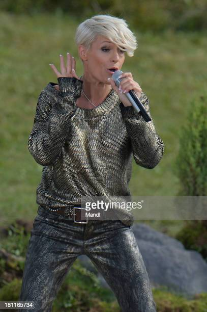 Michelle performs during the recording of the TV Show 'ZDF Fernsehgarten' at Seiser Alm near Kastelruth on September 18 2013 in Kastelruth Italy