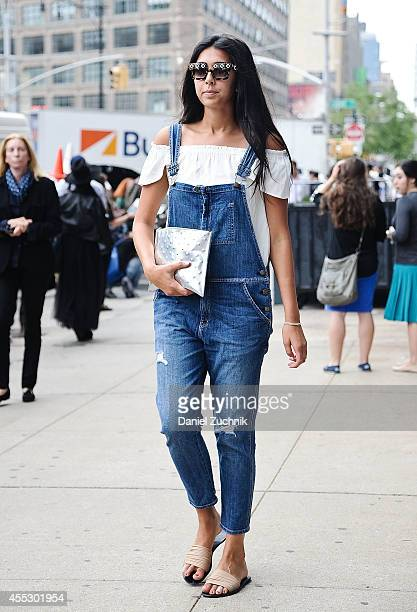 Michelle Persad is seen outside the Calvin Klein show wearing Current Elliot jean overalls on September 11 2014 in New York City