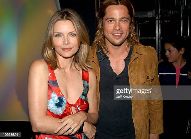 Michelle Pfeiffer and Brad Pitt during Nickelodeon's 16th Annual Kids' Choice Awards 2003 Backstage at Barker Hangar in Santa Monica CA United States